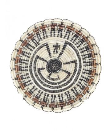 Miniature man in the maze basket by Elizabeth Juan (Tohono O'odham)