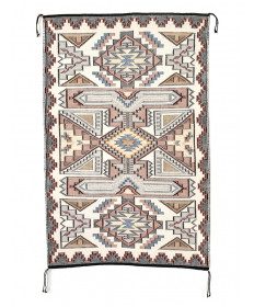 Teec Nos Pos raised outline rug by Marjorie Donegie (Navajo)